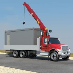 Un camion-grue transporte le conteneur au site de déploiement