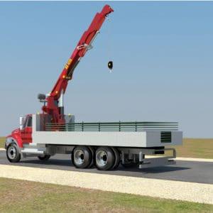 Un camion grue transporte les murs de protection en acier jusqu'au site de déploiement